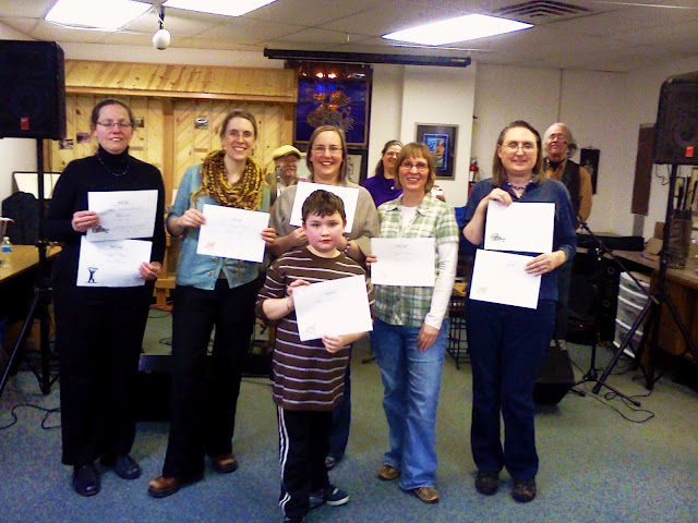 Winners (l to r) Lisa, Ruth, Alaina standing in for Michael, Cara, Judy.  Front row - Connor