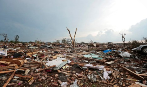 MOORE, OK - MAY 20: Debris covers the ground after a powerful tornado ripped through the area on May 20, 2013 in Moore, Oklahoma.
