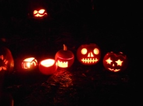 Carved pumpkins ring the Corn King