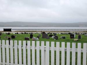 My first sight of the memorial was over the graveyard of the Lutheran church. The section to the right was designed by the architect Peter Zumthor, while Louise Bourgeois designed the structure to the left and its contents. — at Steilneset Memorial in Vardø, Norway .